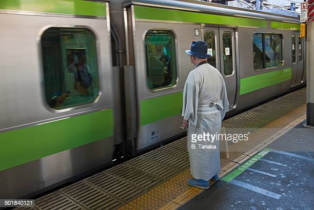 Gentleman and Yamanote Train in Tokyo, Japan
