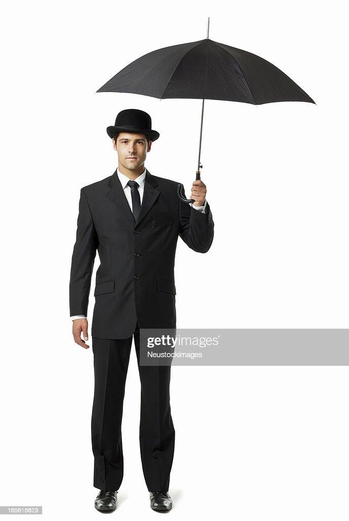 9e49c728936 Gentleman Holding an Umbrella - Isolated. RF. Bowler Hat