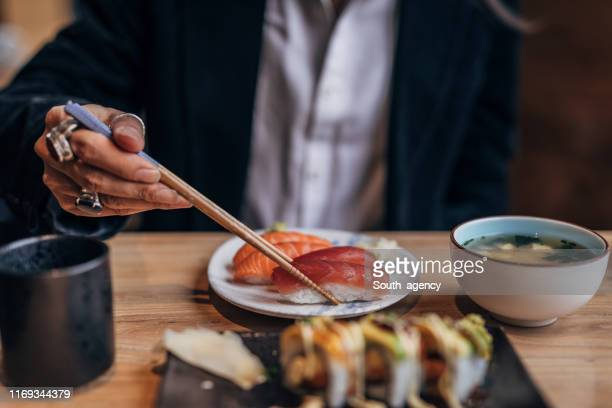 gentleman in sushi bar - japanese food stock pictures, royalty-free photos & images