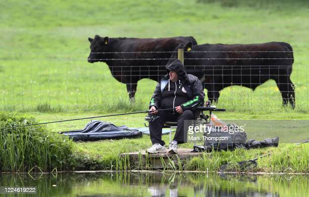 Gentleman is seen fishing at Castle Ashby lakes as restrictions are eased on some leisure activities on May 13, 2020 in Northamptonshire, England....