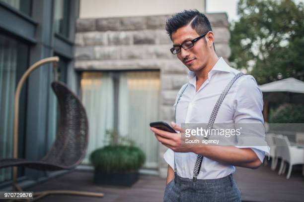 gentleman it his back yard - handsome chinese men stock pictures, royalty-free photos & images
