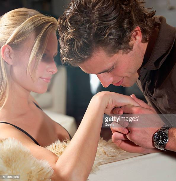 Gentleman Kissing Hand of Blond Young Woman