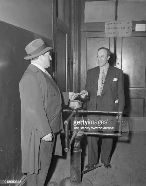 A gentleman pays for entry into Stillman's Gym circa 1955 in New York City New York