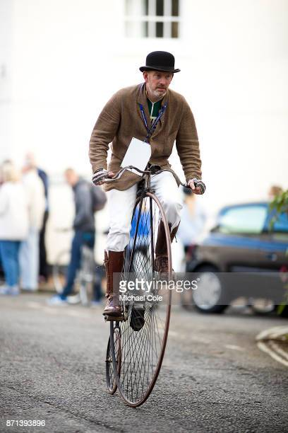 Gentleman riding a 'Penny Farting' bicycle during the 121st London To Brighton Veteran Car Run on November 5 2017 in Cuckfield West Sussex England