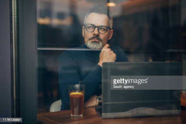 gentleman sitting in cafe - polo neck stock pictures, royalty-free photos & images