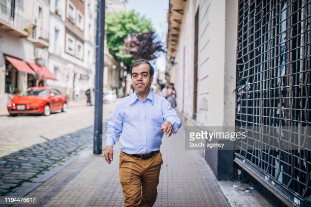 gentleman walking on the street downtown - dwarf man stock pictures, royalty-free photos & images