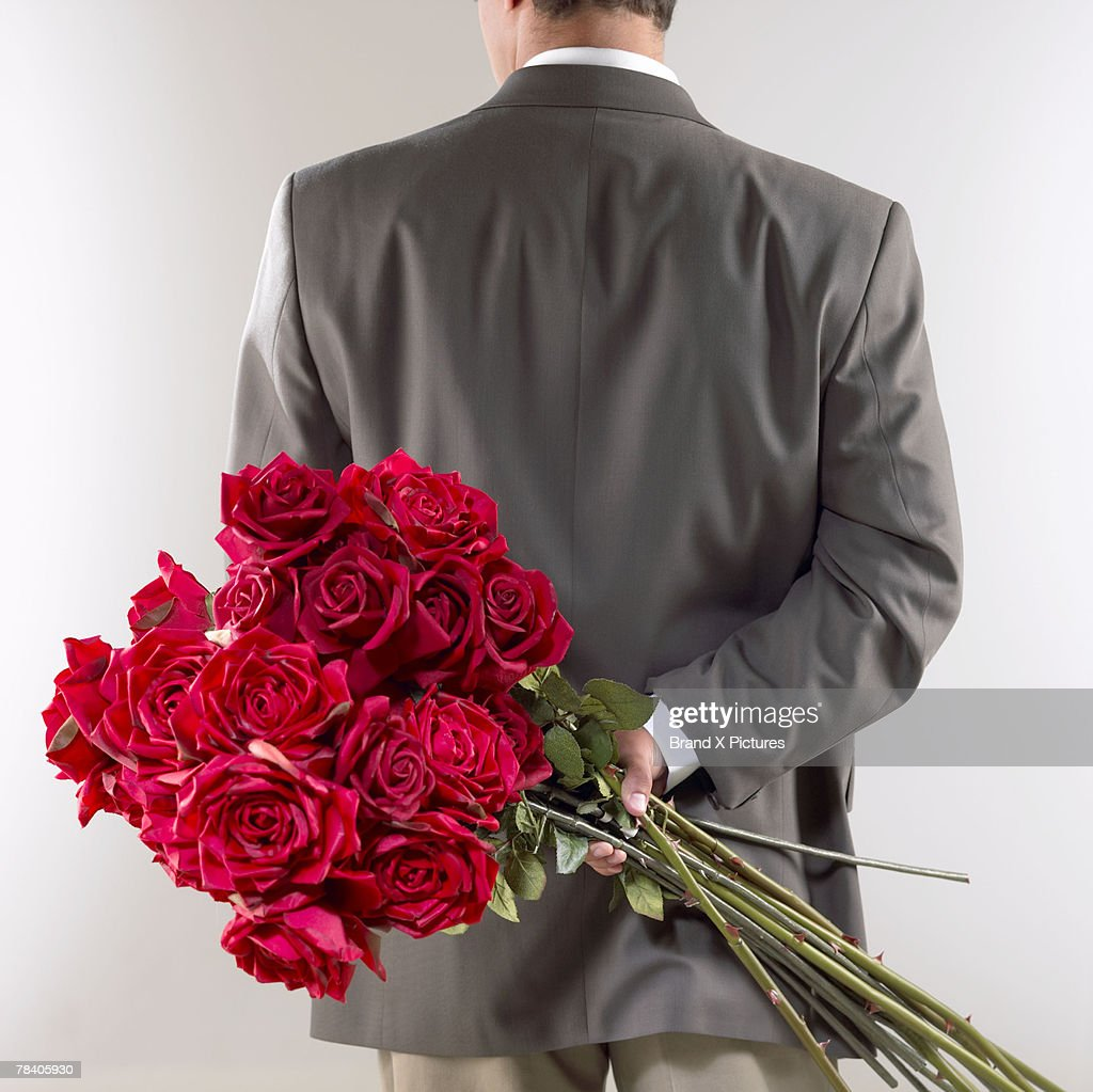 Gentleman with red roses : Stock Photo