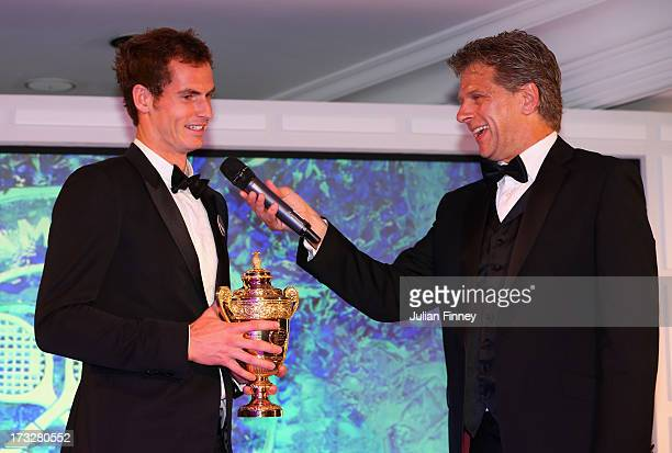 Gentlemans' Singles Champion Andy Murray of Great Britain is interviewed by Andrew Castle during the Wimbledon Championships 2013 Winners Ball at...