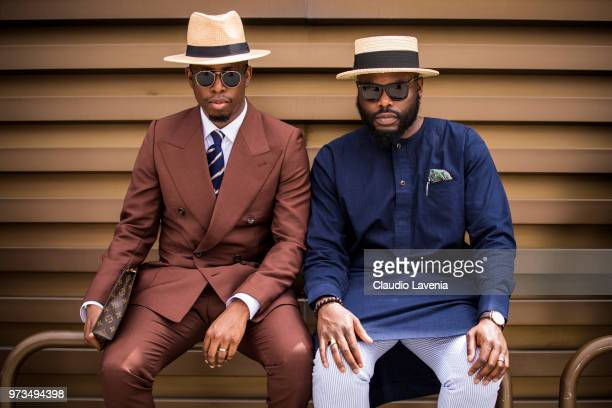 Gentlemen, wearing suits, are seen during the 94th Pitti Immagine Uomo at Fortezza Da Basso on June 13, 2018 in Florence, Italy.