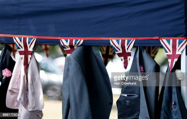 Gentlemens jackets hang up as they picnic in the car park on day 2 of Royal Ascot at Ascot Racecourse on June 21 2017 in Ascot England