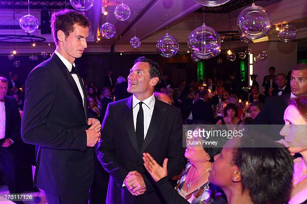 Gentlemen's Singles Champion Andy Murray of Great Britain talks to Roger Draper is the Chief Executive of the Lawn Tennis Association during the...