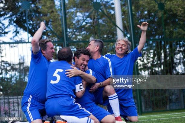 gentlemen's soccer team celebrates embraced a goal - soccer league stock pictures, royalty-free photos & images