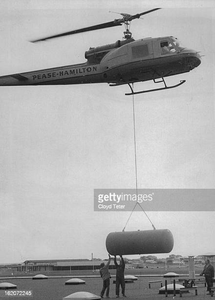 MAY 11 1968 MAY 12 1968 Gently Now Helicopter lowers one of five 2700pound air receivers onto roof of Samsonite Building at Montbello Interstate 70...