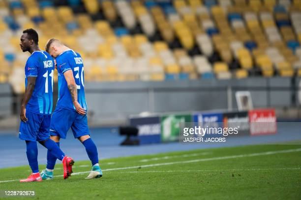 Gents Anderson Niangbo and Gents Niklas Bernd Dorsch looks dejected after a game between Ukrainian club Dynamo Kyiv and Belgian soccer club KAA Gent...