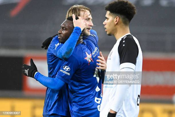 Gent's Anderson Niangbo and Gent's Roman Bezus celebrate after scoring during a soccer game between KAA Gent and KFC Heur-Tongeren , Wednesday 03...