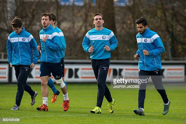 Gent's Benito Raman Brecht Dejaegere Sven Kums and Kenneth Saief warm u p during a training session at the team's training centre in Gent on December...