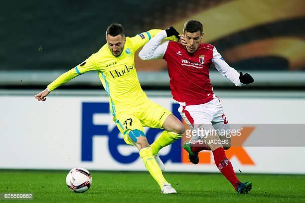 Gent's Bosnian midfielder Danijel Milicevic vies with Braga's Portuguese Pedro Tiba during the UEFA Europa League football match between KAA Gent and...