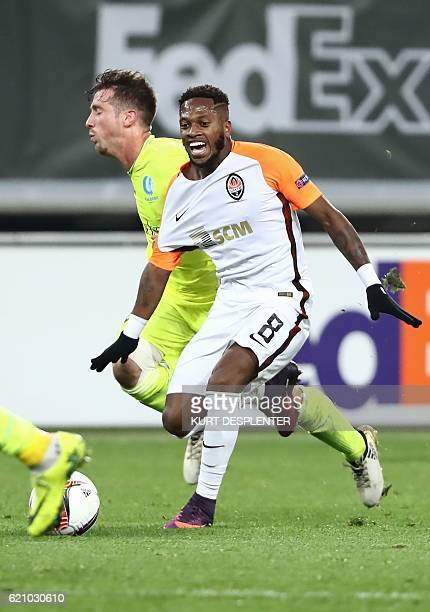 Gent's Brecht Dejaegere and Shakhtar Donetsk's Brazilian midfielder Frederico Rodrigues Santos aka Fred vie for the ball during the UEFA Europa...