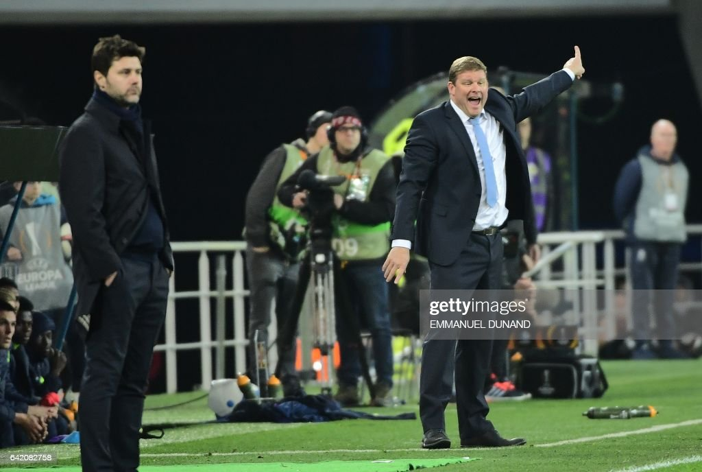 Gent's coach Hein Vanhaezebrouck (R) and Tottenham Hotspur's coach Mauricio Pochettino (L) look at their players during the UEFA Europa League match between KAA Gent and Tottenham Hotspur at the Ghelamco Arena on February 16, 2017 in Ghent. Gent won 1-0. / AFP / EMMANUEL