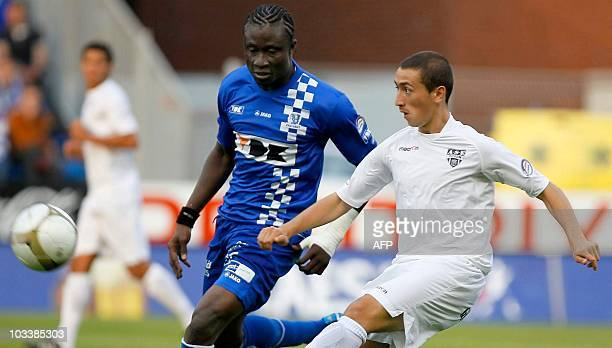 Gent's Elimane Coulibaly and Eupen's Enez Saglik fight for the ball during the Jupiler Pro League match between AA Gent and Eupen in Gent on August...