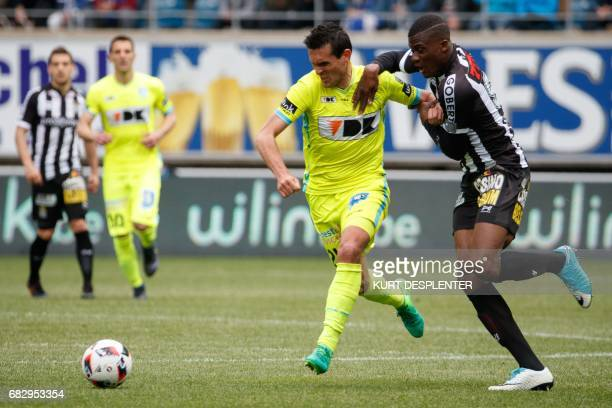 Gent's French forward Jeremy Perbet and Charleroi's Ivorian forward Chris Bedia vie for the ball during the Jupiler Pro League football match between...