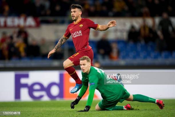 Gent's goalkeeper Thomas Kaminski pictured as AS Roma's Carles Perez scores a goal during a 1/16 finals game of the UEFA Europa League between...