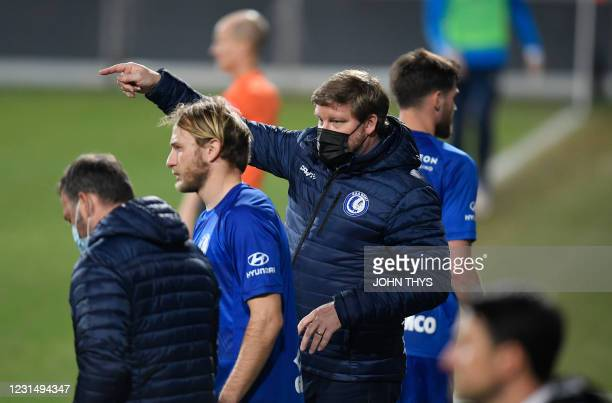 Gent's head coach Hein Vanhaezebrouck , is pictured, with, Gent's Roman Bezus and during a soccer game between KAS Eupen and KAA Gent, Wednesday 03...