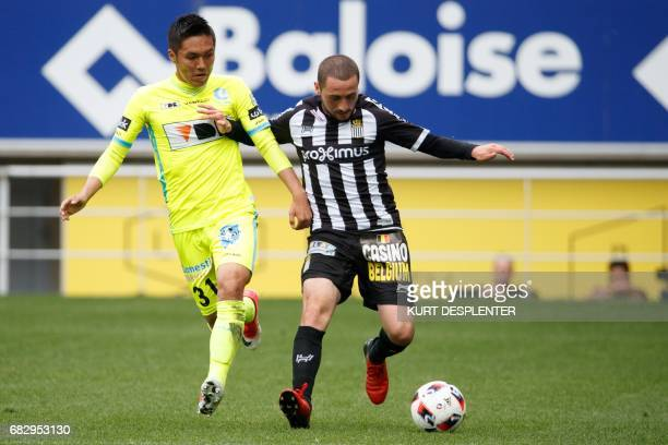 Gent's Japanese forward Yuya Kubo and Charleroi's Turkish midfielder Enes Saglik vie for the ball during the Jupiler Pro League football match...
