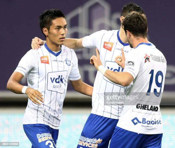 Gent's Japanese striker Yuya Kubo celebrates with his teammates after opening the scoring in a 30 home win over Eupen in the Belgian first division...