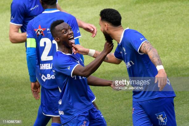Gent's Jean-Luc Diarra Mamadou Dompe celebrates after scoring during a soccer game between KAA Gent and KV Mechelen, the final of the Croky Cup...