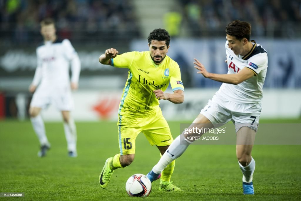 Gent's Kenneth Saief and Tottenham's forward Son Heung-Min during the UEFA Europa League football match between KAA Gent and Tottenham, on February 16, 2017, in Ghent. / AFP / BELGA / JASPER JACOBS / Belgium OUT
