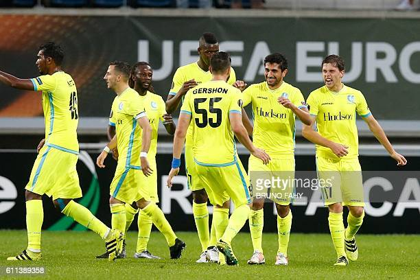 Gent's Kenneth Saief celebrates with his teammates after scoring during a game on the second day of the group stage of the Europa League competition...