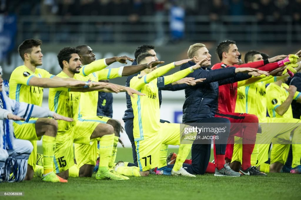 Gent's players celebrate after winning the UEFA Europa League football match between KAA Gent and Tottenham, on February 16, 2017, in Ghent. / AFP / BELGA / JASPER JACOBS / Belgium OUT