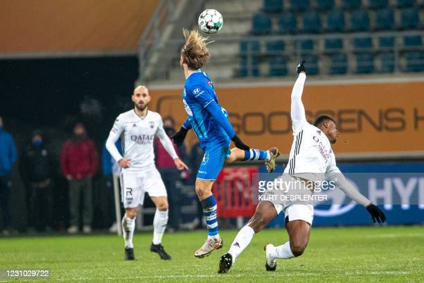 Gent's Roman Bezus and Eupen's Edo Kayembe fight for the ball during a soccer match between KAA Gent and KAS Eupen, Sunday 07 February 2021 in Gent,...