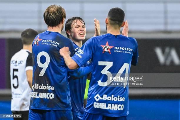Gent's Roman Bezus, Gent's Matisse Samoise and Gent's Tarik Tissoudali celebrate after scoring during a soccer game between KAA Gent and KFC...