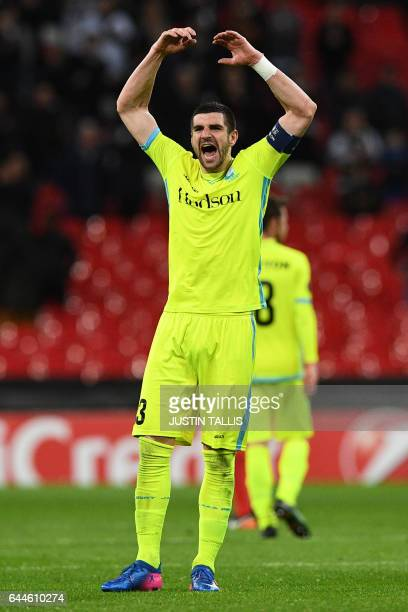Gent's Serbian defender Stefan Mitrovic celebrates at the end of the UEFA Europa League Round of 32 secondleg football match between Tottenham...