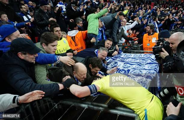 Gent's Serbian defender Stefan Mitrovic celebrates with Gent supporters at the end of the UEFA Europa League Round of 32 secondleg football match...