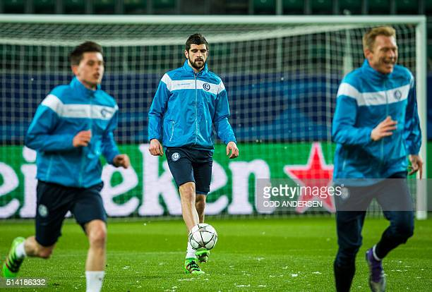 Gent's Serbian defender Stefan Mitrovic controls the ball during a training session on the eve of the secondleg round of 16 UEFA Champions league...
