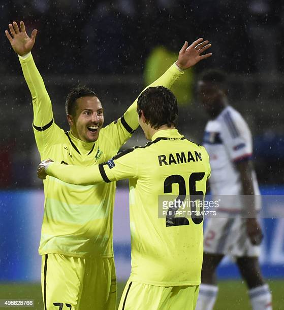 Gent's Serbian midfielder Danijel Milicevic jubilates with Gent's Belgian forward Benito Raman at the end of the UEFA Champions League group H...