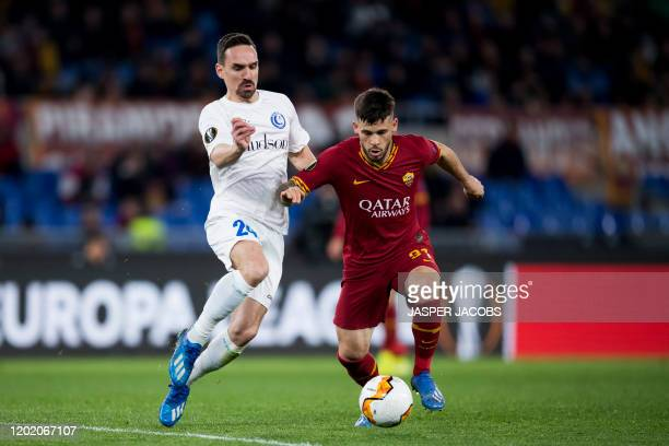 Gent's Sven Kums and AS Roma's Carles Perez fight for the ball during a 1/16 finals game of the UEFA Europa League between Belgian soccer club KAA...