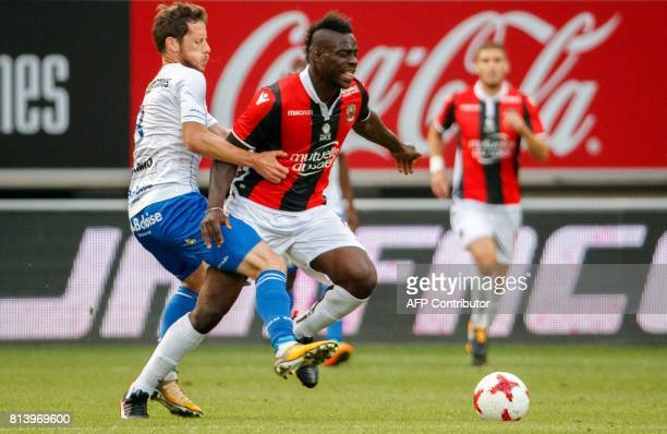 Gent's Thomas Matton and Nice's Mario Balotelli vie for the ball during a friendly football match between Belgian first league soccer team KAA Gent...