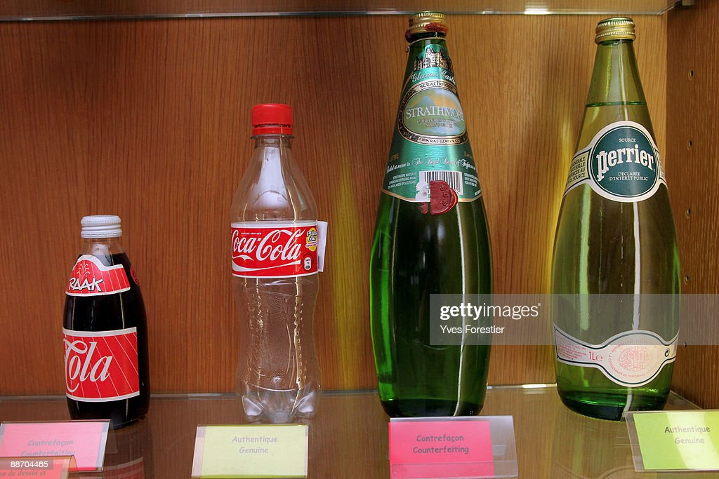 Genuine and fake Coca Cola and Perrier bottles displayed at