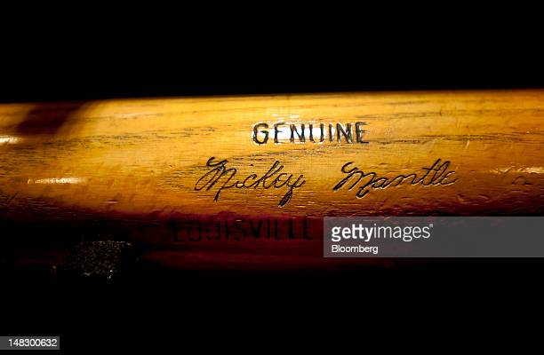 A genuine Mickey Mantle bat hangs on display at the Louisville Slugger Museum and Factory in Louisville Kentucky US on Friday July 13 2012 The...