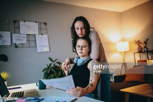 gen-z lesbian couple working from home and sharing love - fiancé stock pictures, royalty-free photos & images