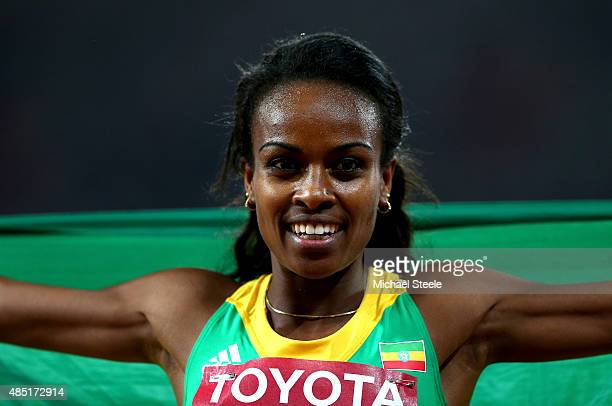 Genzebe Dibaba of Ethiopia celebrates after winning gold in the Women's 1500 metres final during day four of the 15th IAAF World Athletics...