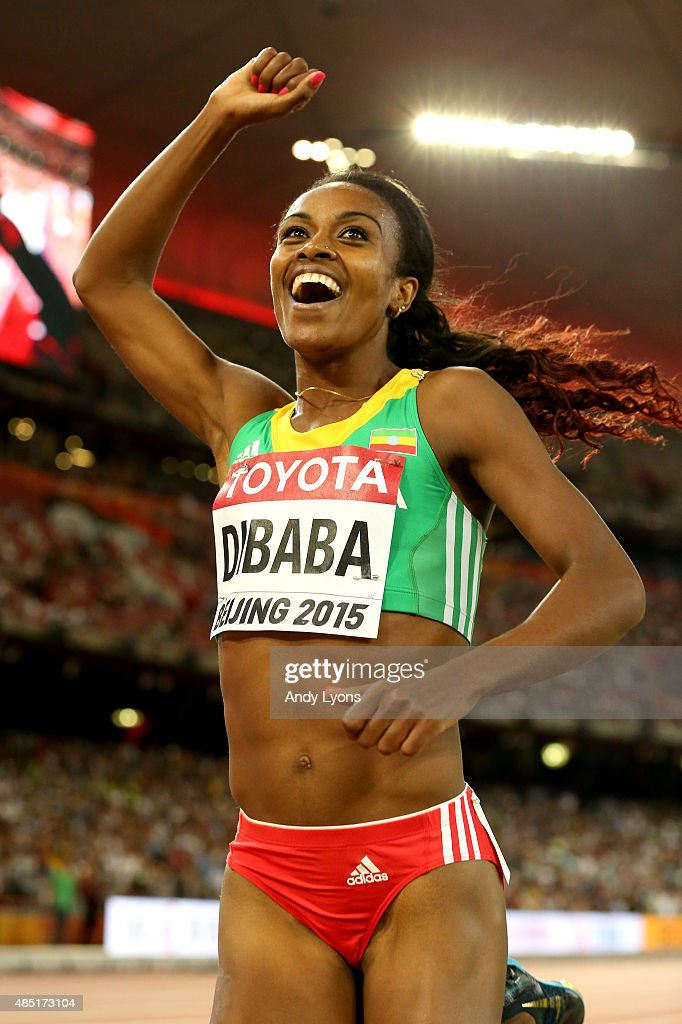 Genzebe Dibaba of Ethiopia celebrates after winning gold in the Women's 1500 metres final during day four of the 15th IAAF World Athletics Championships Beijing 2015 at Beijing National Stadium on August 25, 2015 in Beijing, China.