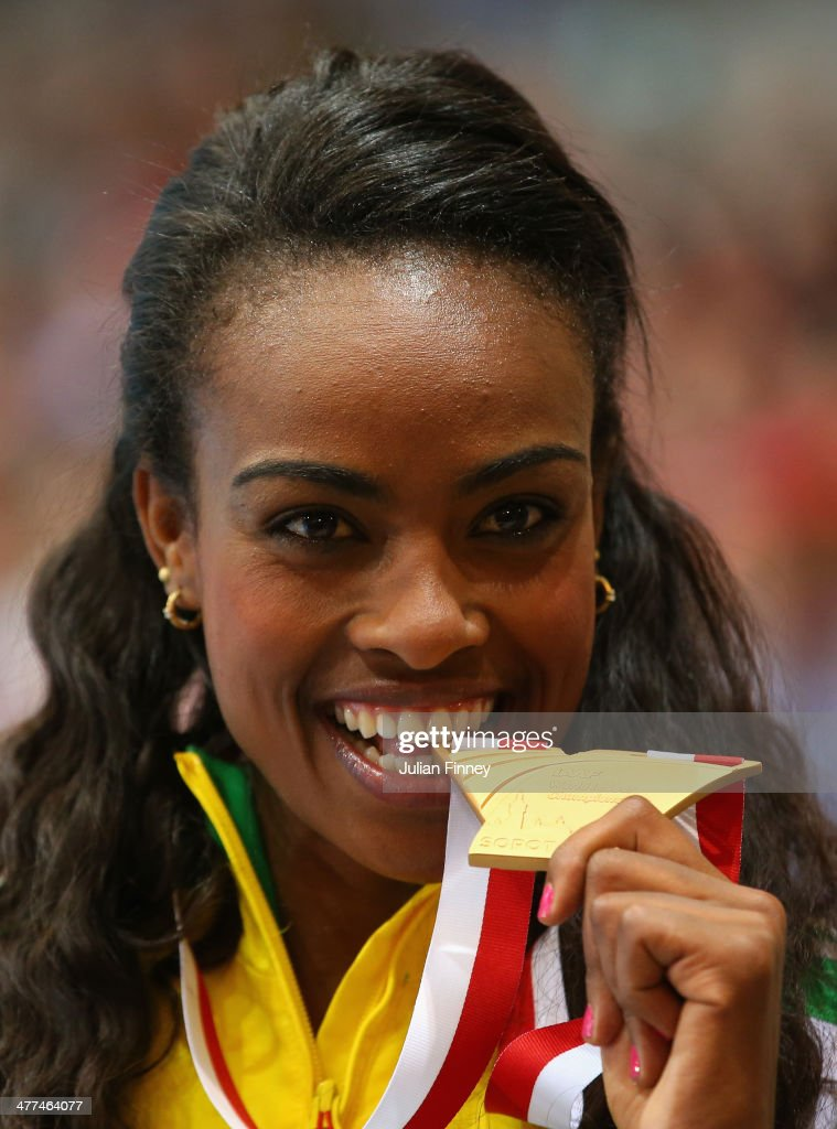 Genzebe Dibaba of Ethiopia celebrates winning the gold medal in the Women's 3000m final during the medal ceremony on day three of the IAAF World Indoor Championships at Ergo Arena on March 9, 2014 in Sopot, Poland.