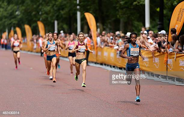 Genzebe Dibaba of Ethiopia leads the field during the women's mile race at the Sainsbury's Anniversary Games at Horse Guards Parade on July 20 2014...