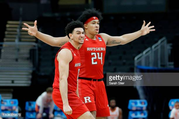 Geo Baker and Ron Harper Jr. #24 of the Rutgers Scarlet Knights react after a play in the second half against the Clemson Tigers in the first round...