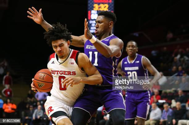 Geo Baker of the Rutgers Scarlet Knights drives to the basket as Anthony Gaines of the Northwestern Wildcats defends during the second half of a game...